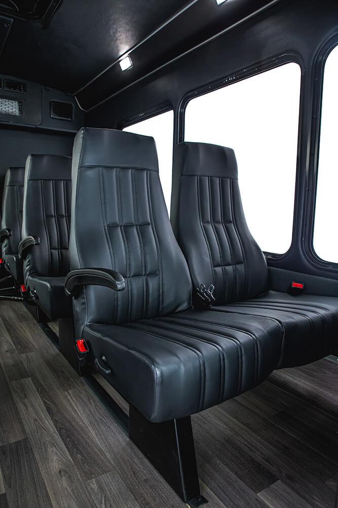 luxury reclining seats inside shuttle bus rental