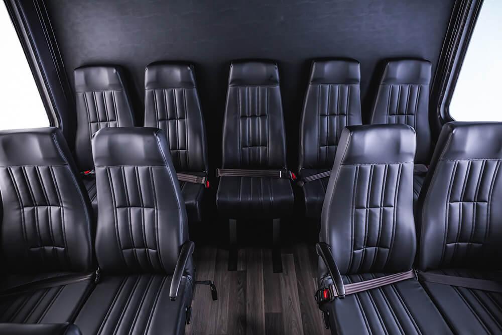 comfortable seating inside 35 passenger shuttle bus