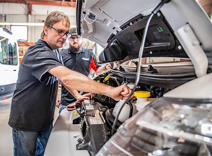 shuttle bus repair mechanic working on engine