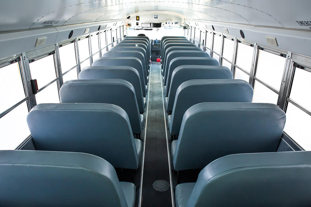 spacious seating inside school bus rental