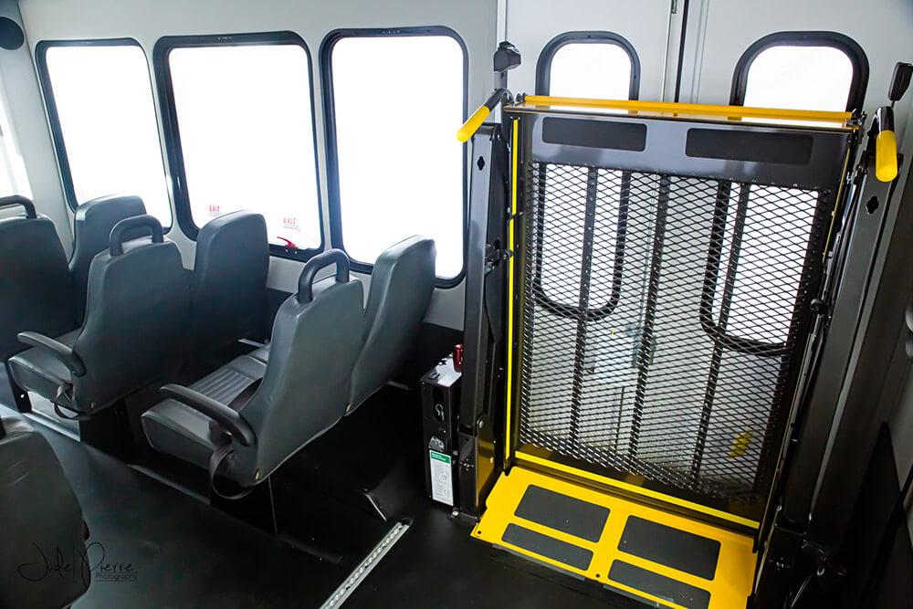 wheelchair lift inside small bus rental