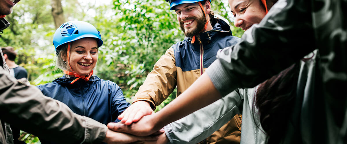 employees enjoying an outdoor adventure together